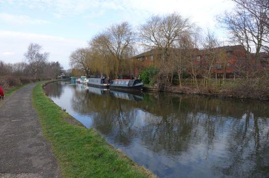 An encampment of narrow boats along towards the Hall Lane Bridge.